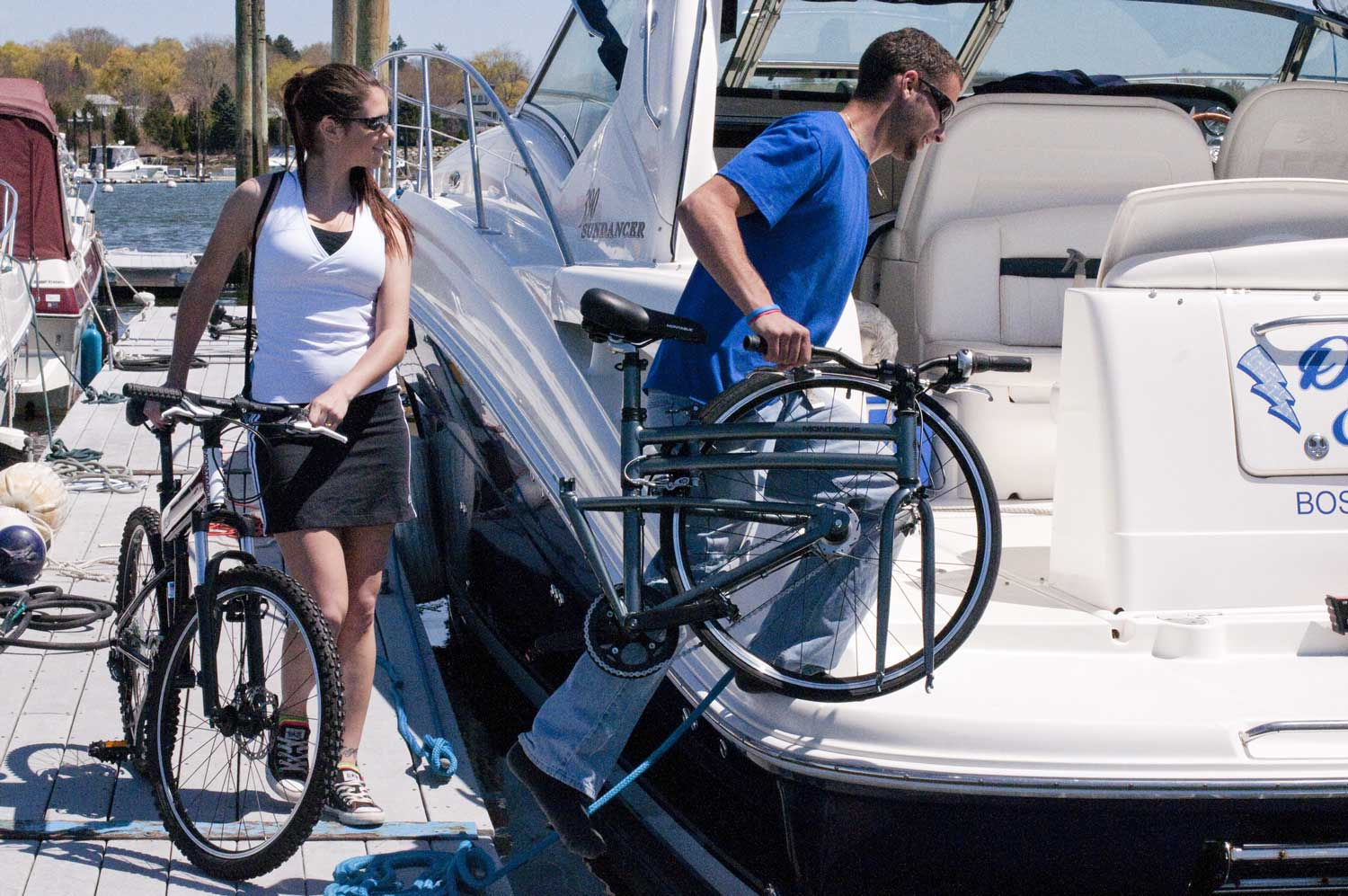 Man and Woman with Folding Bikes on Boat
