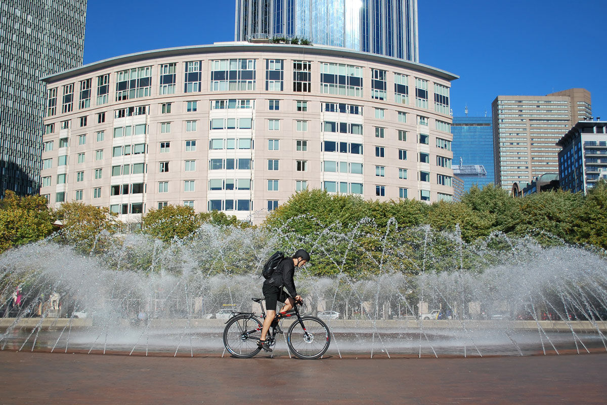 Allston-riding-by-fountain-in-boston