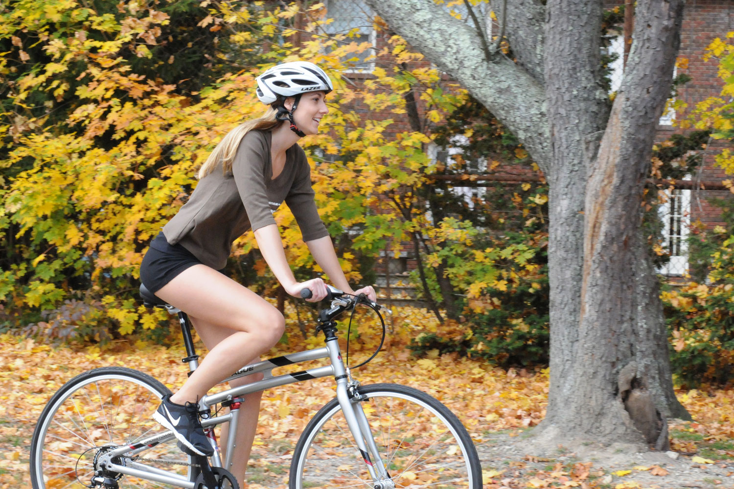 Crosstown-woman-riding-in-autumn
